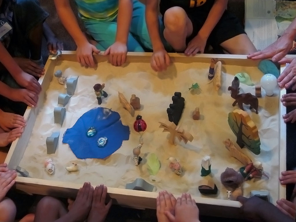 little hands in the sandbox, building a better world for all