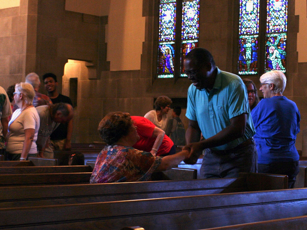 passing the peace in summer worship
