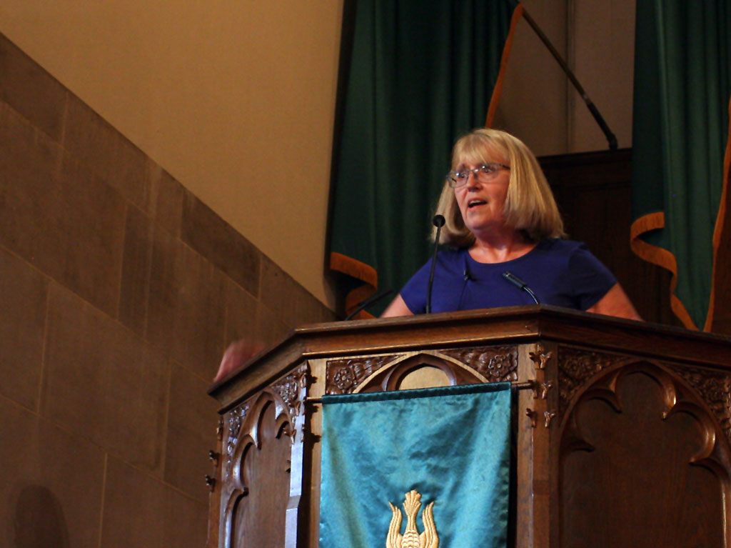 Reverend Beckie in the pulpit
